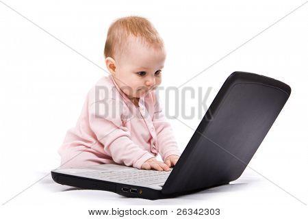 little computer genius baby girl with laptop