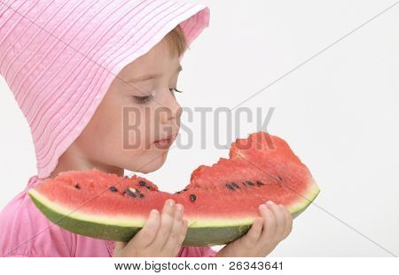 girl eats fresh water-mellon
