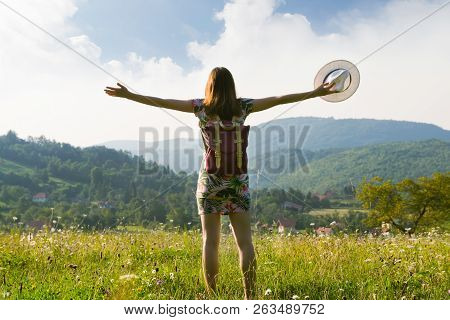 poster of Girl In Vacation. Summer Vacation. Traveler Girl Walking Through Fields. Young Girl Traveler Walking