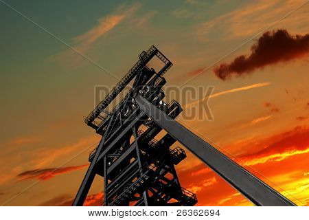 mine shaft tower at sunset sky