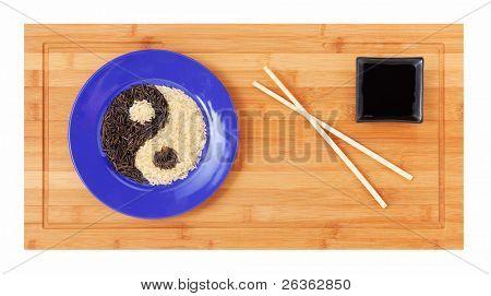 Dish of wild  and white rice,  yin yang symbol