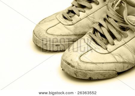 heavy used sneakers isolated on white background