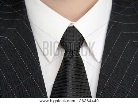 business man concept, detail of a business man suit with black tie
