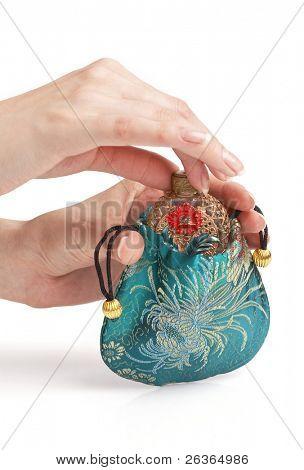 woman hands on vintage perfume bottle