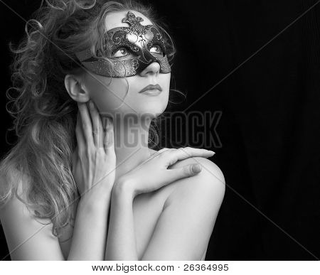 portrait of a sensual beautiful blond young woman with carnival mask, role play