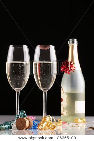 Champagne and two full glasses , one with lipstick mark on it