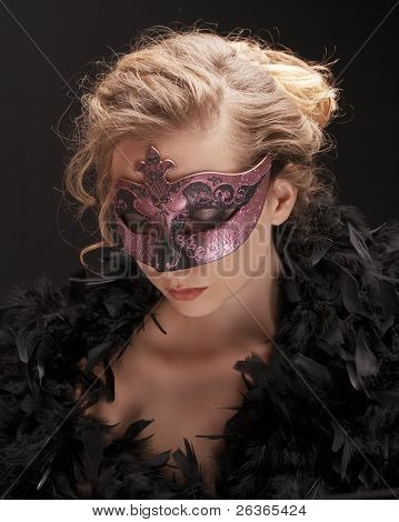 mysterious blond woman wearing carnival mask, role play