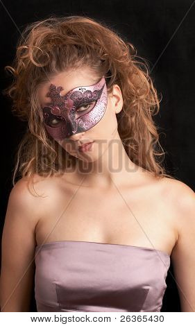 blond woman wearing purple carnival mask and satin top, theater act, role play