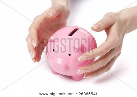 saving money, protecting income, woman hands protecting piggy bank