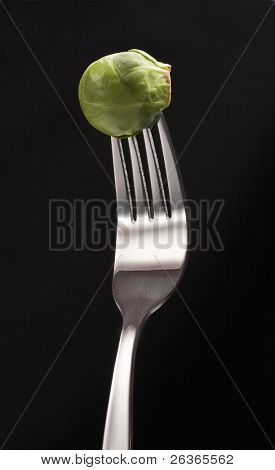 brussels sprouts on a fork, healthy food concept