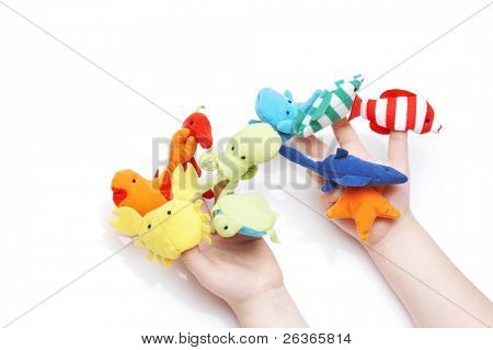 child's hands playing with finger puppets
