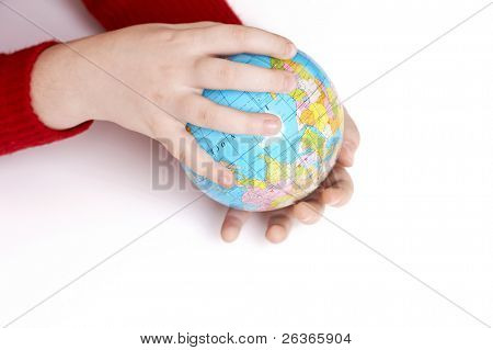 Earth globe in child's hands, learning about the environment