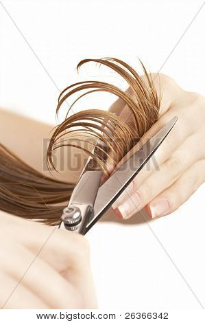 hairdresser cutting wet hair close-up, beauty salon