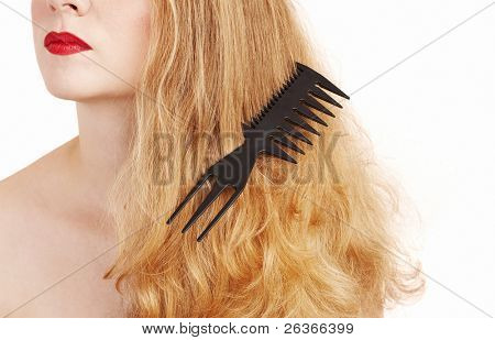 blond woman with comb in her hair