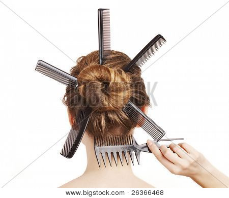 woman with different combs in her hair, hairdo concept