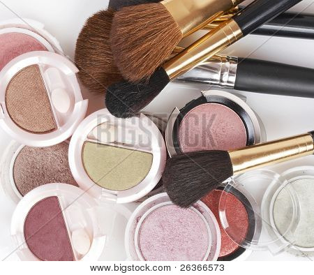 makeup brush and colorful cosmetics