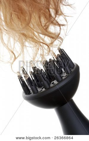 professional hair-dryer and blond curls; beauty salon