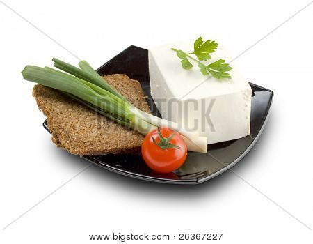 cherry tomato, fetta cheese onion and wholemeal bread on a black plate ; a healthy meal