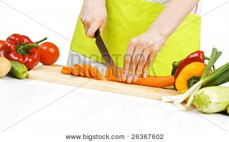 woman cutting carrots; preparing food