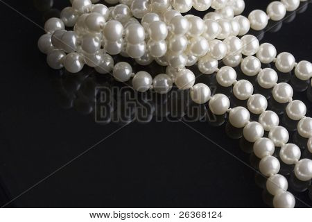 white pearls reflected on black
