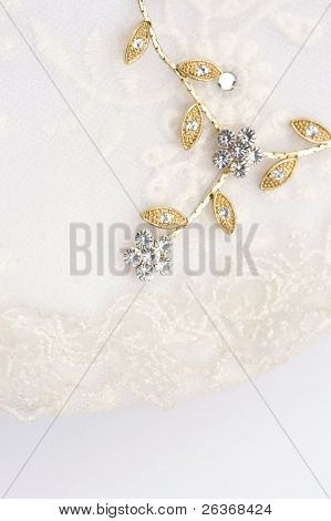 close up of textile wedding background, delicate jewelry on a corset