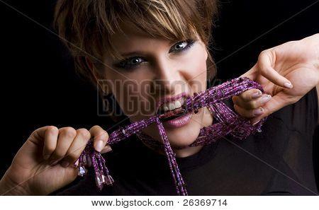 angry woman biting purple beads