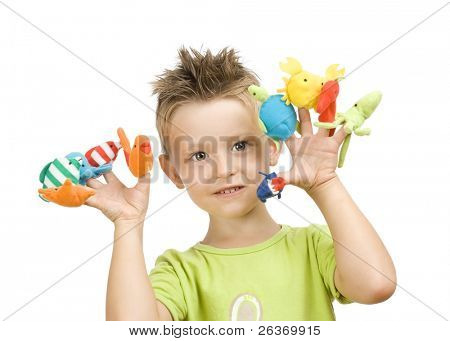 cute little boy playing with finger animal puppets