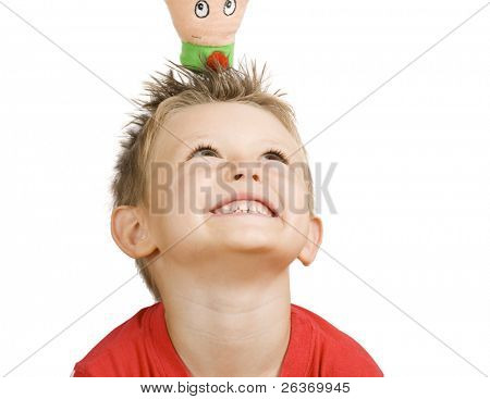 happy little boy playing with puppet