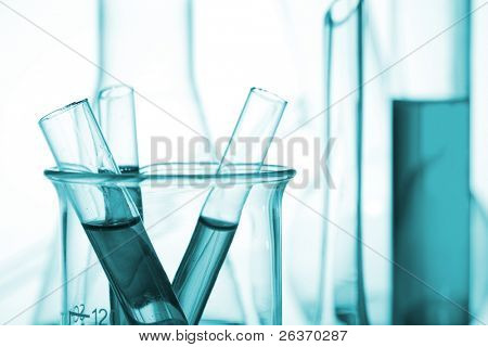 chemistry laboratory equipment, test tubes on green background