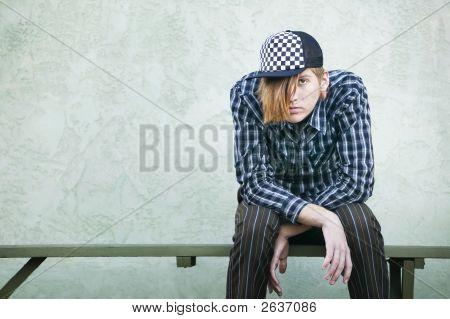 Teenage Boy On A Bench