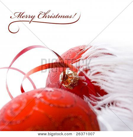 Christmas background; two red globes and white feathers