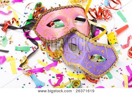 carnival masks and colorful confetti on white