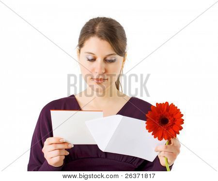 girl reading Valentine card and holding red flower