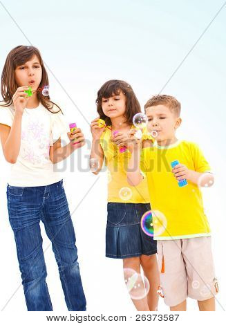 children playing with soap bubbles