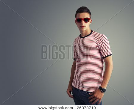 young trendy male model posing in studio