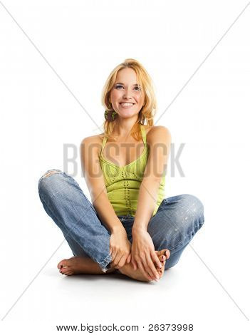happy young woman sitting on the floor and laughing