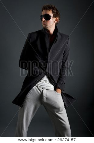 male model posing in trendy clothes