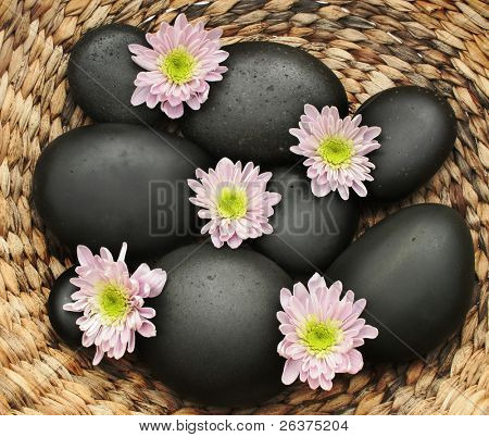 Spa products. Massage stones and exotic flower