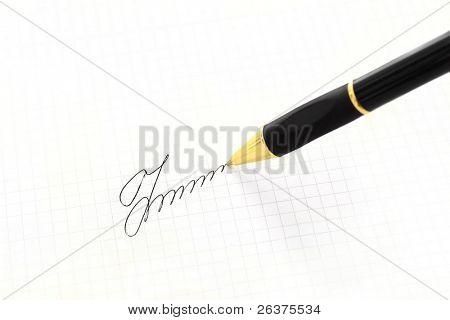 Caneta e assinatura