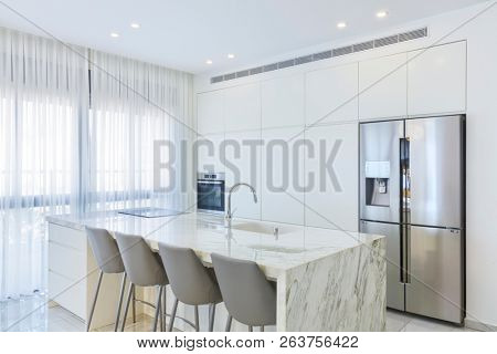 poster of Modern Design Of Luxury White Kitchen With Marble Island