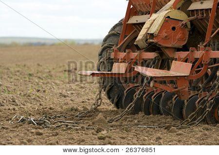 Close-up of seeding machine at field.