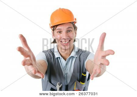 Smiling construction worker with his arms outstretched. Image with clipping path.