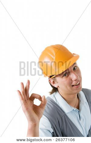 Smiling construction worker showing okay gesture. Image with clipping path.