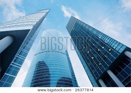 Three skyscrapers, business center in megalopolis