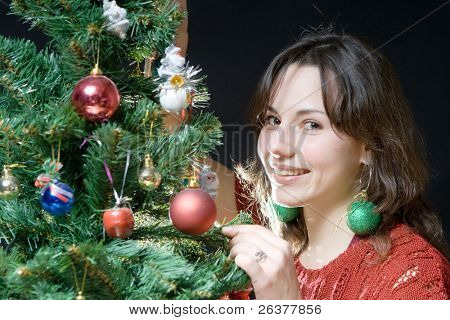 Young woman decorate Christmas tree