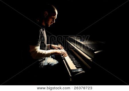 Pianist playing on electric piano