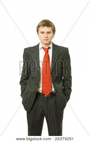 One good-looking young man is standing with his hands in pockets wearing the lounge suit.