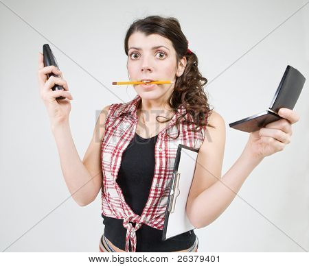 Young woman doing many works simultaneously