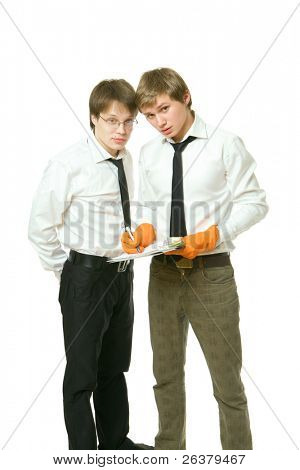 One young man wearing orange rubber gloves is holding a document in his hand and another man is standing close to him