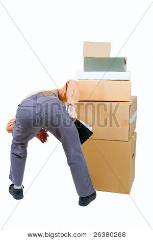 photo of a man stooped over the boxes holding pen and paper in hands
